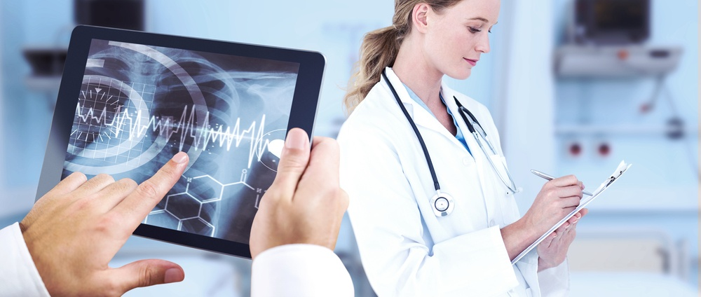 Man using tablet pc against sterile bedroom