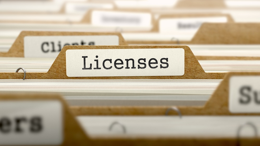 Licenses Concept. Word on Folder Register of Card Index. Selective Focus.